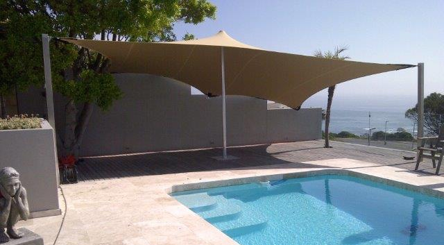 Own your own stretch tent; wind and shade shelter by the pool
